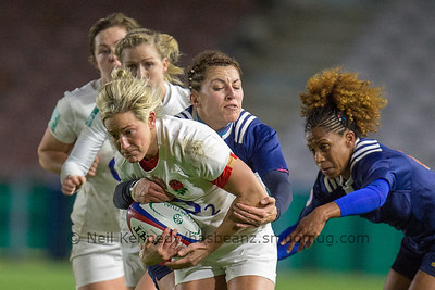 Claire Allan is tackled by Laetitia Grand and Rose Thomas