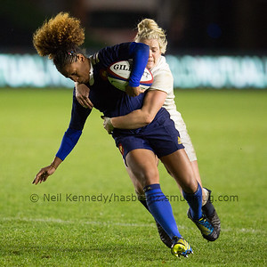 Rose Thomas is tackled by Rachael Burford