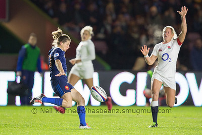 Claire Allan looks to charge down Chris Le Duff's kick