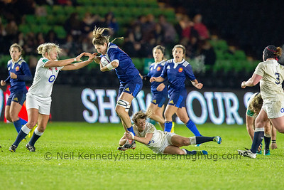 Lenaig Corson driving on but Katy McLean holds the tackle