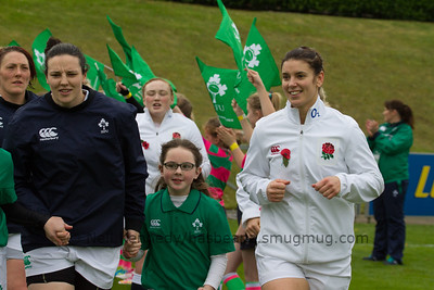 Paula Fitzpatrick (L) and Sarah Hunter (R) lead their teams onto the pitch with the mascot