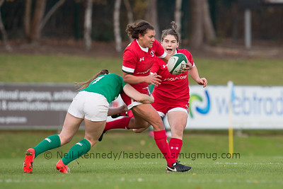 Gillian Boag moves in to support Mackenzie Higgs as she is tackled by Anna Caplice