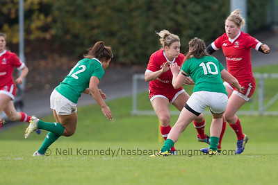 Andrea Burk, with the ball, about to be tackled by Nikki Caughey with Sene Naoupu closing in