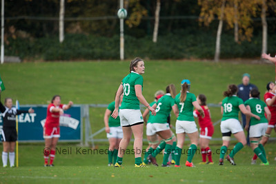 Nikki Caughey checks the back line as a lineout is taken