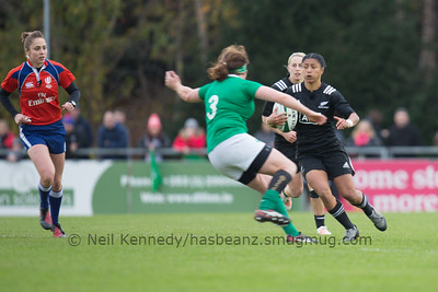 Renee Wicklifffe with the ball as Ailis Egan closes in to tackle