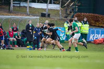 Portia Woodman charges for the try line