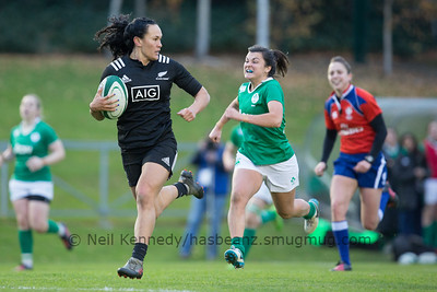 Portia Woodman with the ball and Mary Healy in pursuit