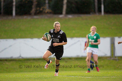 Kelly Brazier with the ball crosses the try line