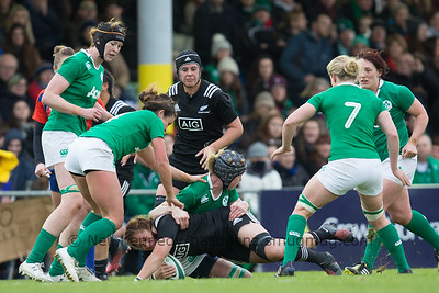 Fiao'o Fa'amausili goes to ground, tackled by Orla Fitzsimons