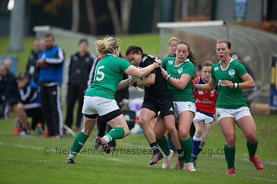 Selica Winaita is tackled by Niamh Briggs and Nicole Fowley