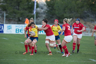 Nerea Agirre with the ball is tackled by Sioned Harries