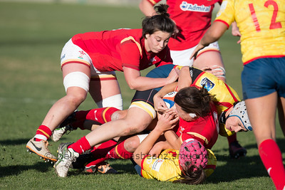 Breakdown:  Sian Williams (with the ball) is tackled and Sioned Harries moves into cover as the ruck forms