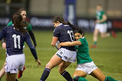 Sene Naoupu tackles Lisa Thomson