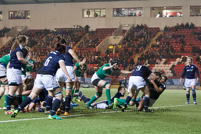 Paula Fitzpatrick is tackled by Lisa Thomosn and Sarah Law as she drives for the line