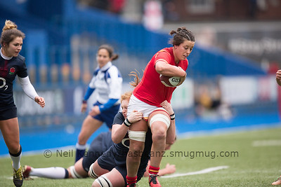 Sioned Harries is tackled by Harriet Millar-Mills