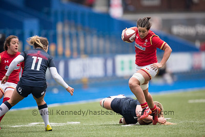 Sioned Harries breaks the tackle and continues