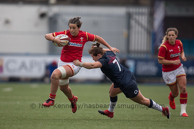 Sioned Harries with the ball is tackled by Marlie Packer