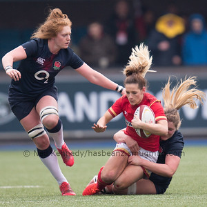 Kerin Lake is tackled by Poppy Cleall