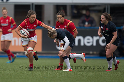 Alisha Butchers with the ball fends Natasha Hunt