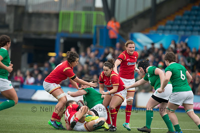 Paula Fitzpatrick is tackled by Alisha Butchers, Lowri Harries and Sioned Harries