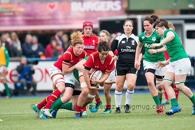 Sioned Harries drives on as she is tackled