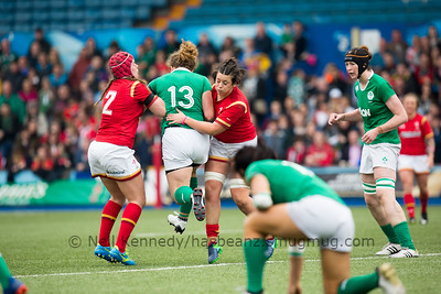 Jenny Murphy is double tackled by Sioned Harries and Carys Phillips