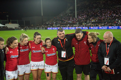 Wales coach Rowland Phillips talks to his players after the game