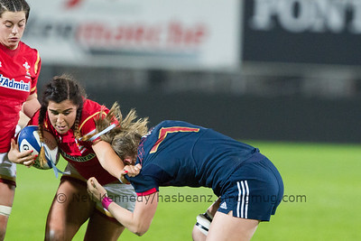 Romane Menager moves in to tackle Shona Powell Hughes