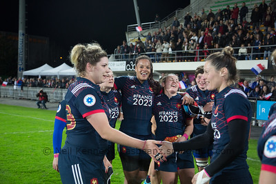 Patricia Caricaburu and Caroline Ladagnous shake hands after the game