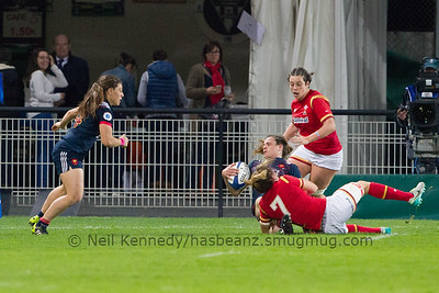 Elodie Poublan is tackled by Rachel Taylor and looks to offload to Chloe Pelle