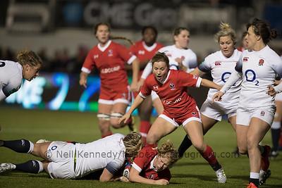 Emily Belchos is tackled