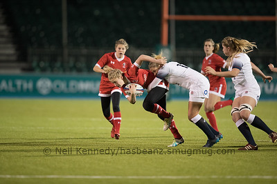 Emily Belchos is tackled by Amber Reed