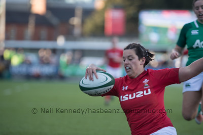 Sioned Harries with the ball, touching down for a try