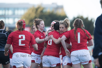 Sioned Harries congratulated by her team mates after scoring a try