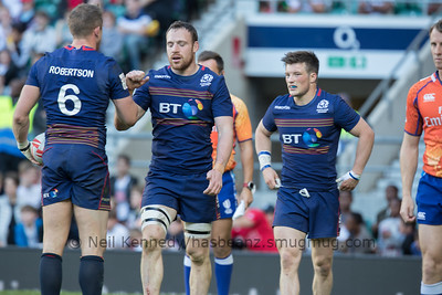 Mark Robertson congratulates Captain, Scott Riddell after Riddell scores the winning try in the last minute of the final