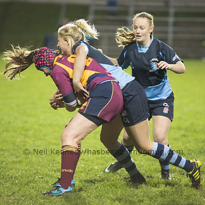 Chloe Davies is tackled by Courtney Gill