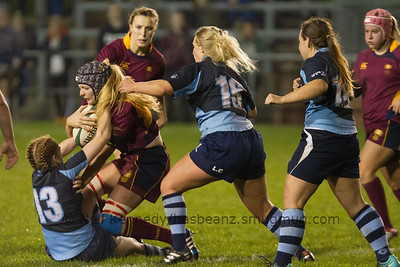 Olivia Jones is tackled by Devon Holt