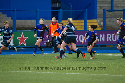 Bethan Dainton with the ball as Becky Newton closes to tackle