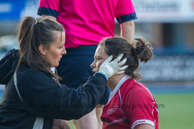 Sioned Harries is checked over by the physio