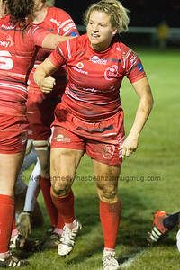 Paula Robinson smiles after scoring a try