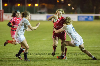 Paula Robinson is tackled by Zoe Aldcroft