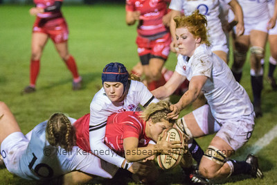 Paula Robinson with the ball about to touch down for a try