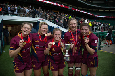 Emily Hull, Georgia Bradley, Meg Daley, Olivia Jones and Ffion Jones with medals and cup