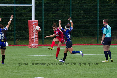 Jodie Evans kicks a clearance