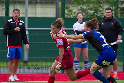 Charlie Murray reaches to tackle Jess Kavanagh Williams
