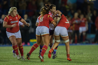 Carrie Roberts drives into the tackles of Shona Powell-Hughes and Sioned Harries