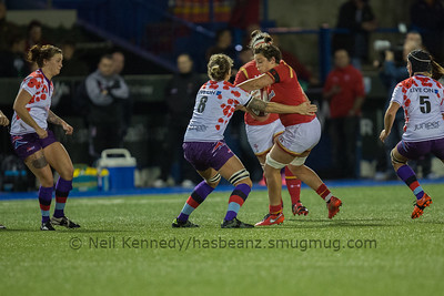 Sioned Harries fends Alex Hardy