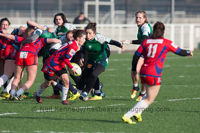 Lena Auriol with the ball after the scrum as Laura Di Muzio moves to tackle
