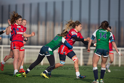 Marjory Mayans gets the ball away as Sytske D'haeseleir tackles her