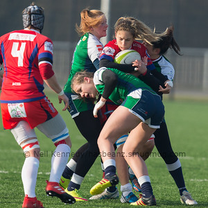 Marjory Mayans with the ball is tackled by 8, Romane Menager and 5, Helene Tissiez